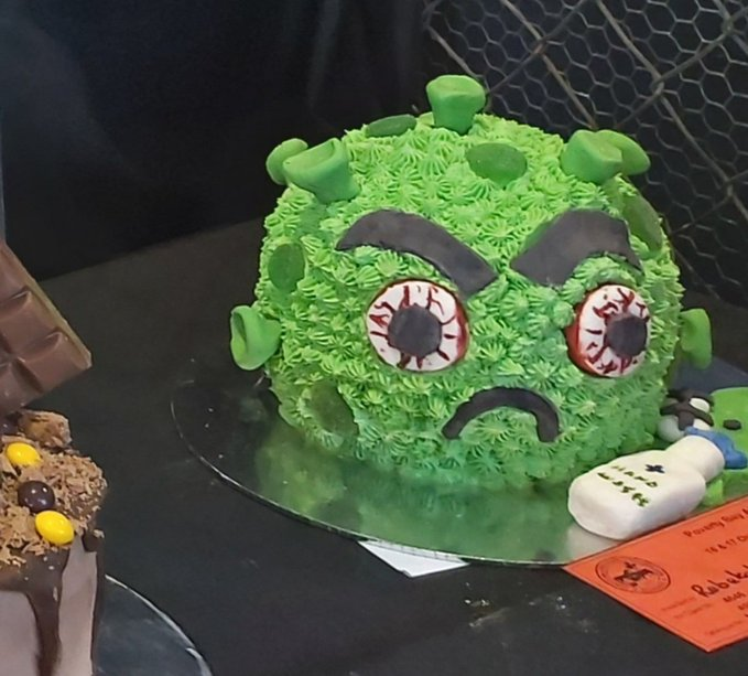 COVID angry-face cake from Turanga-nui-a-Kiwi in New Zealand