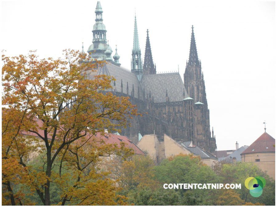 A cathedral roof and autumnal trees in Prague. Copyright Content Catnip 2009