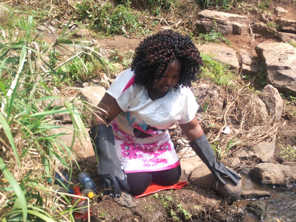 Me cleaning up the Mbagathi river