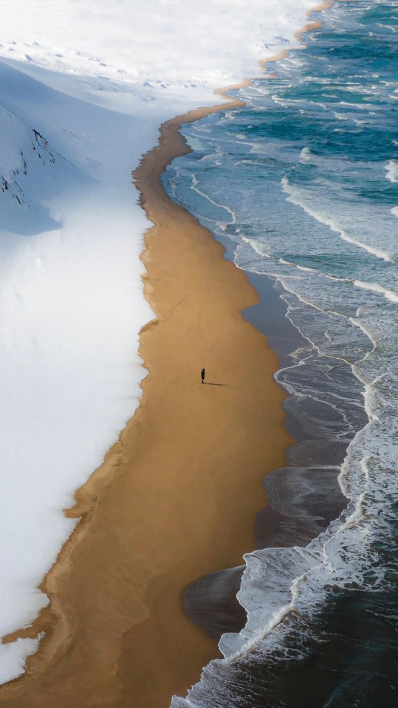 Snow along a lonely stretch of coast of Tottori prefecture, Japan