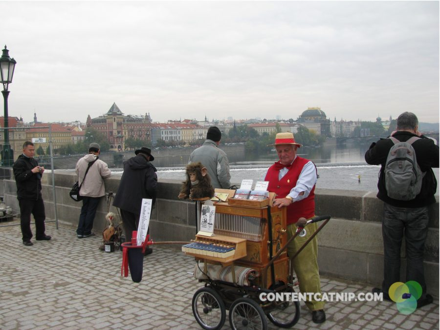 A man plays wistful and sad music on the Charles Bridge in Prague. Copyright 2009 Content Catnip