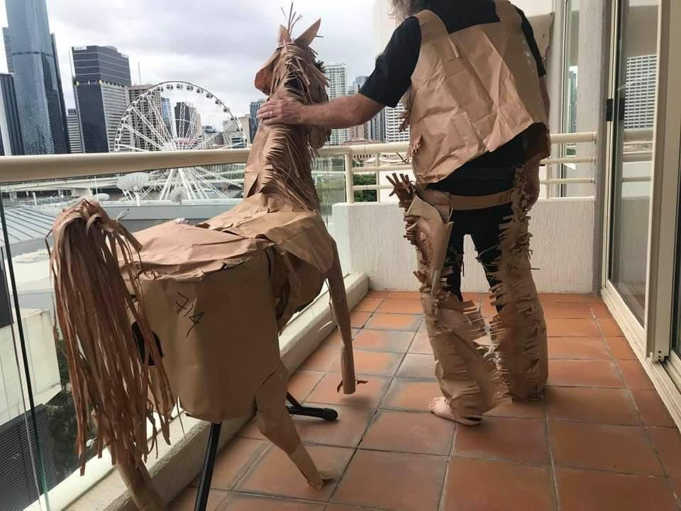 A cardboard horse named Rustle and his cardboard-clad owner ponder their existence in hotel quarantine in Sydney